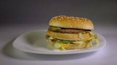 Fried potato chips falling on hamburger, slow motion, fast, junk food concept. Stock Footage