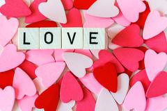 Pile of red and pink hearts with the word love - stock photo