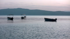 Boats on a lake Stock Footage