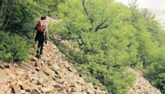 Woman hiking,backpacking in the mountains of Northern Greece,rocky ground Stock Footage