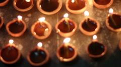 oil lamps lit on diwali festival - stock footage