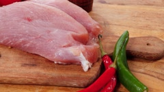 Stock Video Footage of raw turkey meat steak with hot sweet pepper