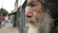Sad and pensive old man homeless looking the street: loneliness, poor man Stock Footage