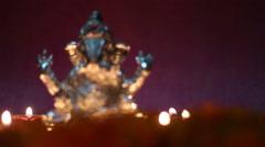 lord ganesha illuminated from oil lamp - stock footage