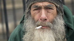 Old homeless smoking: closeup portrait of a real homeless Stock Footage