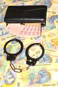 Romanian currency and handcuffs Stock Photos