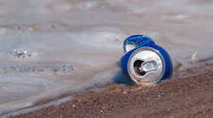 An empty beer can in the dirty water. Water pollution Stock Footage