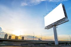 large Blank billboard ready for new advertisement with sunset - stock photo