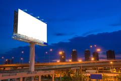 Blank billboard at twilight time for advertisement Stock Photos