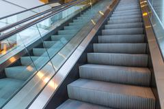 Escalators stairway inside modern office building Stock Photos