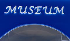Close up of museum sign Stock Photos