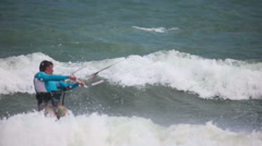 Unidentified kitesurfer surfing on the waves with the kite - stock footage
