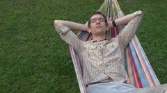Hammock. man sleeping. copy space left. isolated view Stock Footage