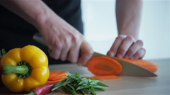cutting carrot cooking vegetables - stock footage
