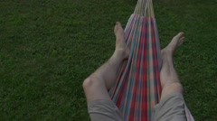 hammock. mans bare legs.copy space left. isolated view - stock footage