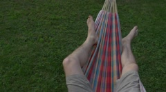 Hammock. mans streteches toes. copy space left. isolated view Stock Footage