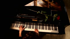 The hands playing grand piano, the top view Stock Footage