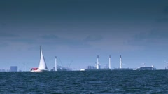 Boat sailing on open blue sea Stock Footage