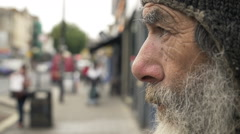 Sad old and lonely man in the street: homeless, jobless, troubled man  Stock Footage
