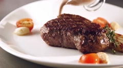 Grill smocked barbecue steak with a flowing sauce in slow motion Stock Footage