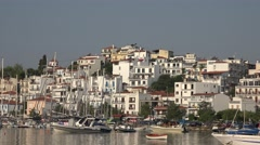 4K Beautiful Greek panorama old town sea port Skiathos island Greece pan left  Stock Footage