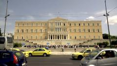 Greek parliament slow motion establishing shot at day,people and traffic Stock Footage