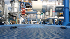 Engineer in process area of chemical plant Stock Footage