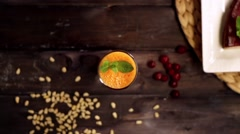 Orange and carrot juice in slow motion Stock Footage