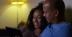An affectionate young couple using a digital tablet at home, Shot on RED Epic. Stock Footage