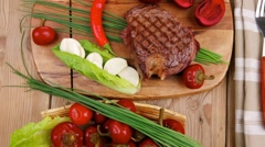 Stock Video Footage of beef ( lamb ) garnished with green lettuce and red pepper