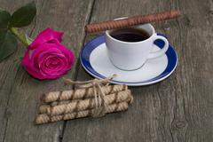 festive card, coffee and red rose and linking of cookies - stock photo