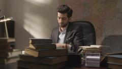 Businessman working and exploring books in the working room Stock Footage