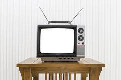 Old Portable Television with Antenna on Wood Table with Cut Out - stock photo
