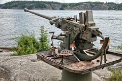 Old rusty anti aircraft gun near Stockholm, Sweden - stock photo