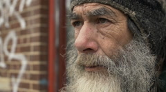 Sad old man in the street closeup portrait: slow motion  Stock Footage