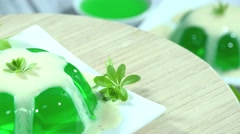 Woodruff Jelly with Vanilla sauce (not loopable) Stock Footage