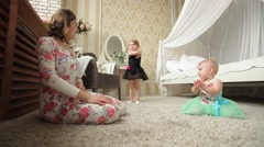 Little girl dances in front of my mother and younger sister. Dolly shot. - stock footage