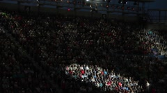 Large Crowd In A Stadium With Spot Lights Panning All Around - stock footage