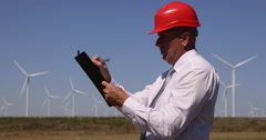 Engineer Taking Notes Clipboard Wind Turbine Farm Looking Man Work Power Plant Stock Footage