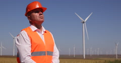 Master Engineer Check Wind Turbines Farm Field System Man Work Looking Up Verify Stock Footage