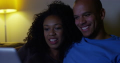 Young couple relaxing at home and doing their on-line shopping. Shot on RED Epic - stock footage