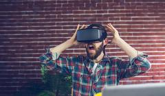 Shocked editor using 3D video glasses Stock Photos