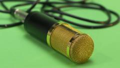 Golden microphone falling. Falls down. Green screen. Slow Motion. Stock Footage