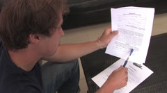 Signing a Waver Before Parachuting out of airplane Stock Footage