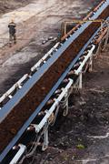 Opencast brown coal mine. Belt conveyor. - stock photo