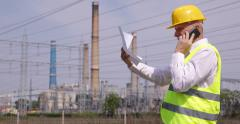 Engineer Man Talking Mobile Phone Energy Power Plant Looking Documents Team Work Stock Footage
