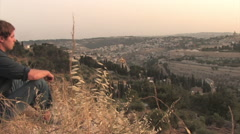 Hiker Viewing The Dome of the Rock from the Mount of Olives Jerusalem, Israel Stock Footage