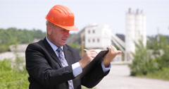 Concrete Pour Plant Engineer Work Calculate Write Clipboard Cement Production US Stock Footage