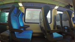 Economy class train with many empty seats moving, no passengers travel, crisis Stock Footage