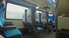 Many empty seats on comfortable intercity express train moving at high speed Stock Footage